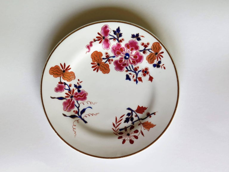 These are a rare pair of plates from the Flight, Barr and Barr period of Worcester porcelain, George IVth period, circa 1825  Both plates are beautifully hand-painted with three bold and very colorful floral sprigs using burnt orange, red, cobalt