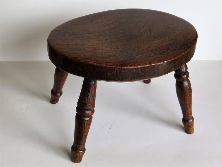 This candle stand or stool is a good example of English Country furniture.