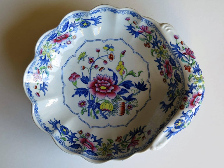 This is an early 19th century stone china (Ironstone pottery) desert dish with a fluted shell shape, produced by Spode and dating from the George 111rd period, circa 1820.  It is decorated in one of Spode's chinoiserie influenced floral patterns