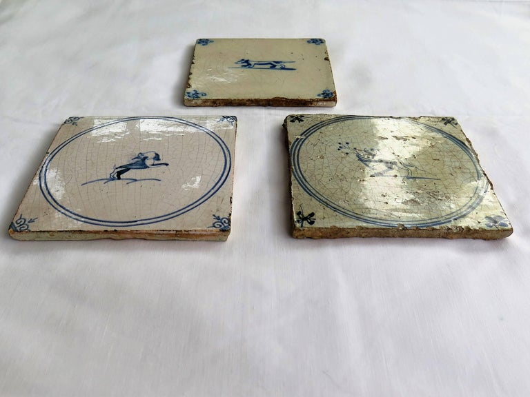 Dutch Colonial Three 18th Century Delft Blue and White Ceramic Wall Tiles, Dog Patterns For Sale