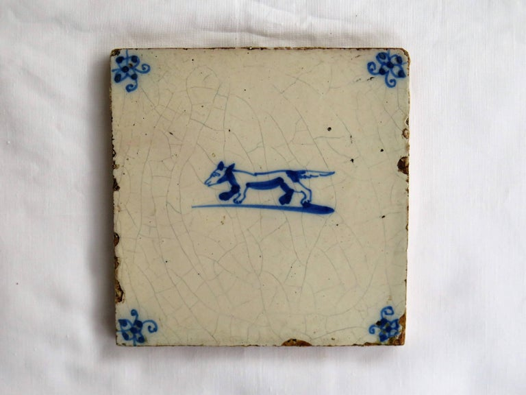 Three 18th Century Delft Blue and White Ceramic Wall Tiles, Dog Patterns For Sale 1