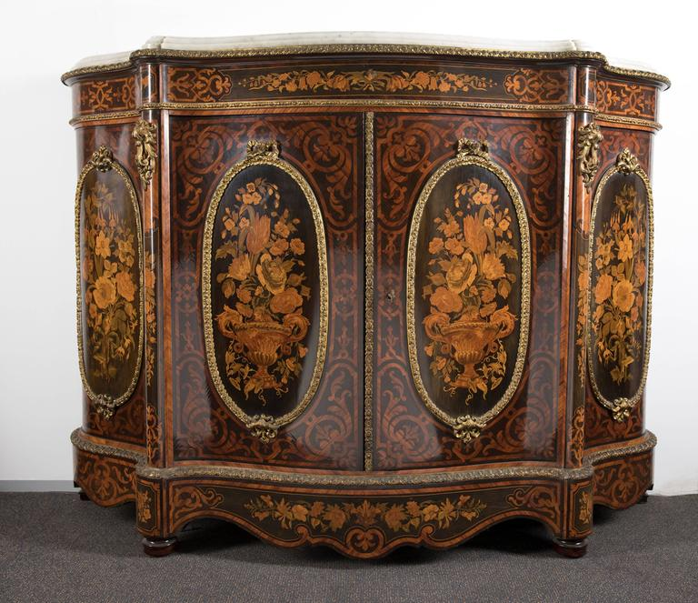 a large and impressive napoleon iii gilt bronze mounted kingwood and fruitwood marquetry meuble d
