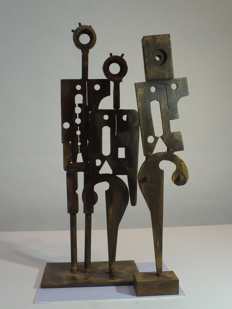 This 2-piece solid steel sculpture is a far more industrial, angular work from Rawlins. Perhaps looking at how people have evolved from earlier more simple eras into today's era of the machine and our reliance on them. However, the piece is not a