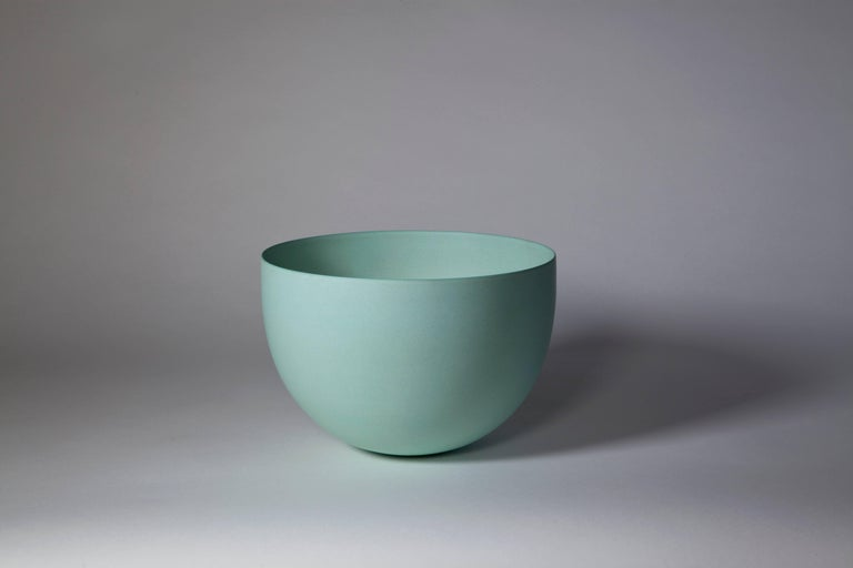 Unique bowl created by Geert Lap. Based on the shape and color, this bowl can be dated circa 1988. In 1987, Lap began using a terra sigilata glaze on his stoneware. This terra sigilata glaze gives a beautiful semi-matte satiny sheen and also