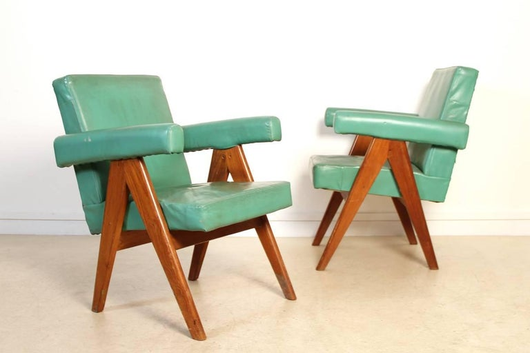 Pair of Chandigarh Committee armchairs. This set of two chairs designed and produced by Pierre Jeanneret for the city of Chandigarh, India have a structure in teak frame with iconic scissor legs, and are covered with a light green coat. Chandigarh
