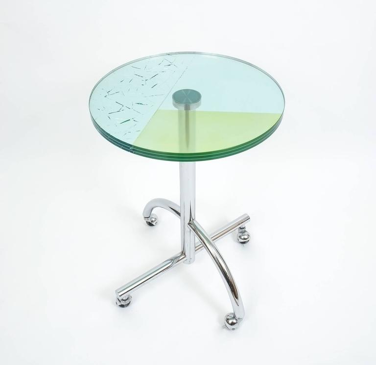 "Iconic table 'Sally' by Shiro Kuramata, Japan, 1987 for Memphis. 20.85"" glass top comprised of sandwiched laminated glass with an in between layer of shattered glass and colored film. The base is made from chrome-plated metal. Excellent quality"