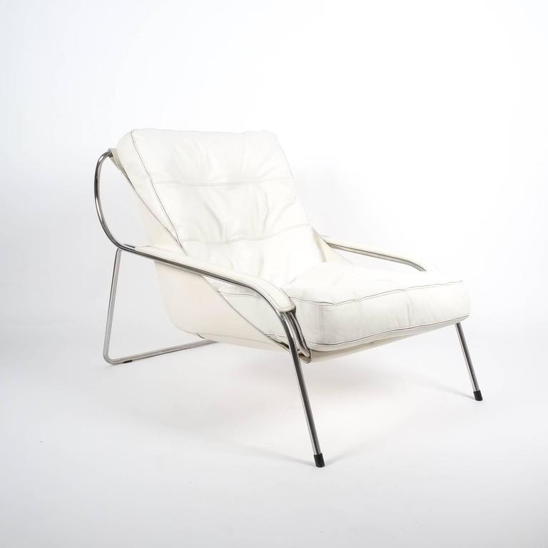 Elegant Maggiolina chair by Zanotta designed by Marco Zanuso, originally designed in 1947. Cowhide sling supports one large Nappa leather cushion. A stainless steel frame supports this very comfortable and sleek lounge chair. The condition is very