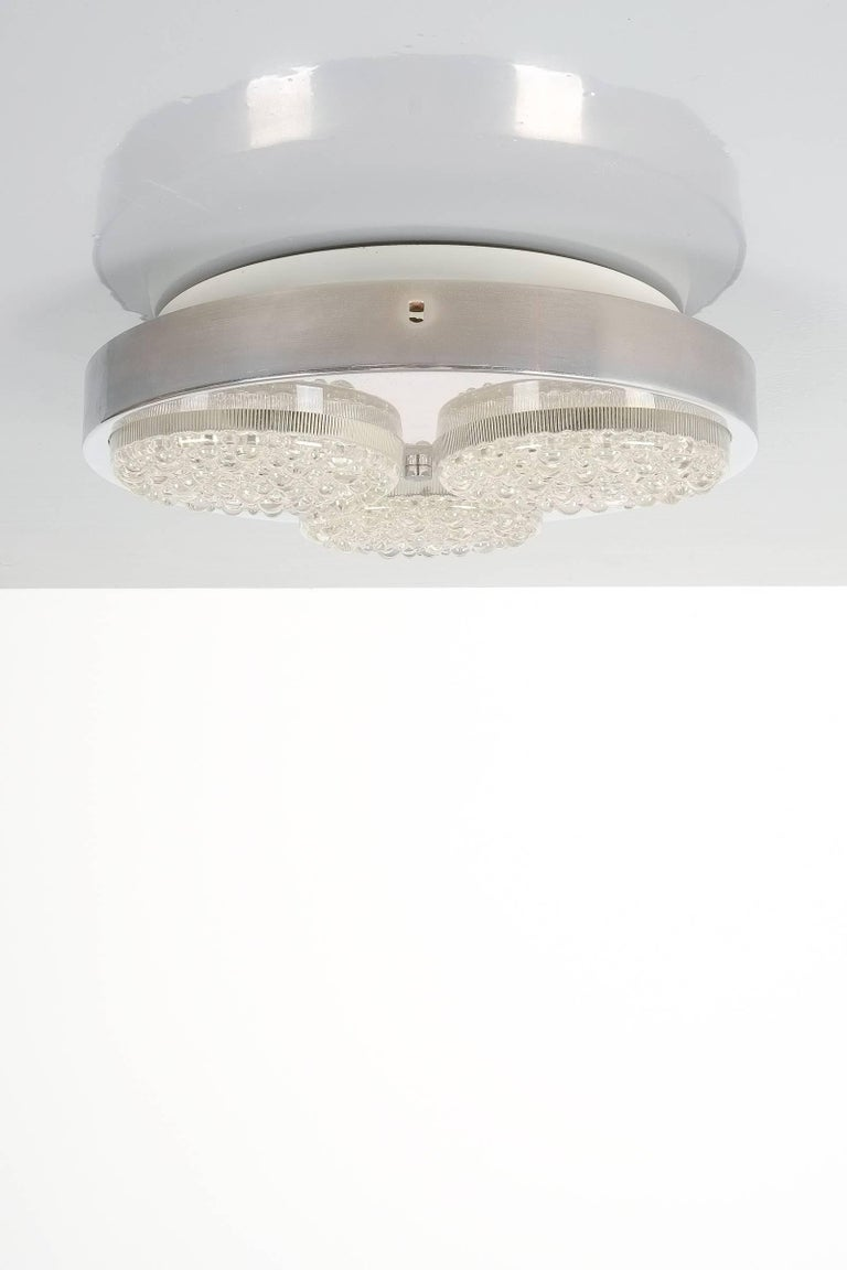 Textured Glass and Aluminum Flush Mount fixture light, Italy 1960. 14.2 inches in diameter, featuring 3 textured glass spots on an aluminum body with white enameled metal base. It takes 3x e14 bulbs with 40W max (supports Led) Measurements are 14.2x