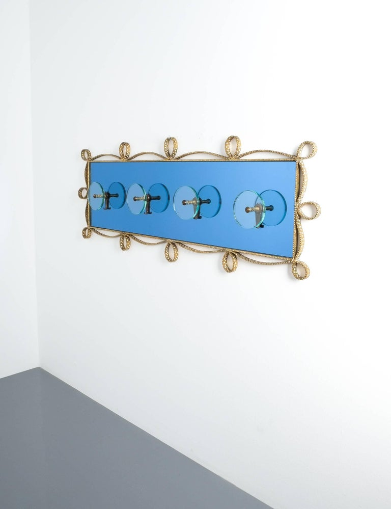 Pier Luigi Colli coatrack wall wardrobe iron blue glass mirror, Italy, 1955 (for Cristal Art Torino) Beautiful coatrack made from smooth glass pieces in mirrored blue and clear glass. Typical Colli ornamental iron frame-work. Excellent condition, no
