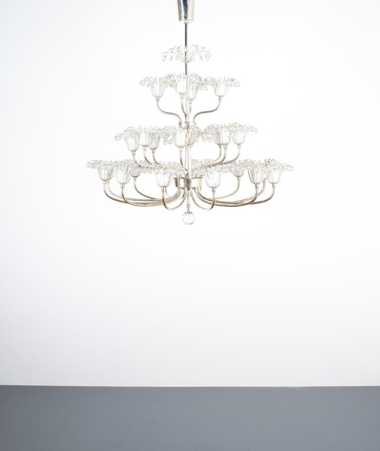 Set of three Emil Stejnar chandeliers silver glass, Austria. Beautiful chandeliers from the 1950s featuring 24 lights (small bulbs e14). Good overall condition, no structural issues, newly rewired; the paint shows some losses. Three pieces