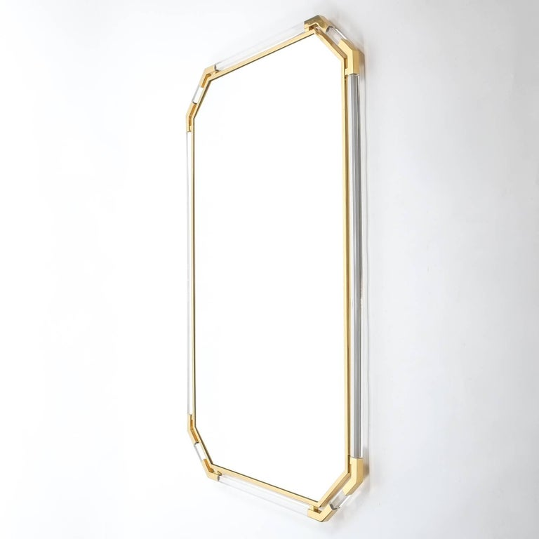 Magnificent 63 inch mirror by Guy Lefevre for Maison Jansen, Paris, 1970. Beautiful double frame mirror with Lucite and brass construction. Heavy quality piece in great condition with hardly any wear to the frame. The mirror can either be hung up