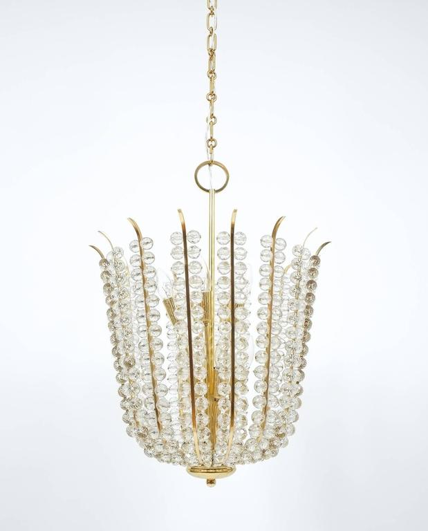 Stunning fully restored chandelier by Bakalowits composed of hundreds of crystals and delicate brass hardware. It's in excellent condition, the crystals have been newly wired, all brass parts polished and it has been newly rewired (US standards).
