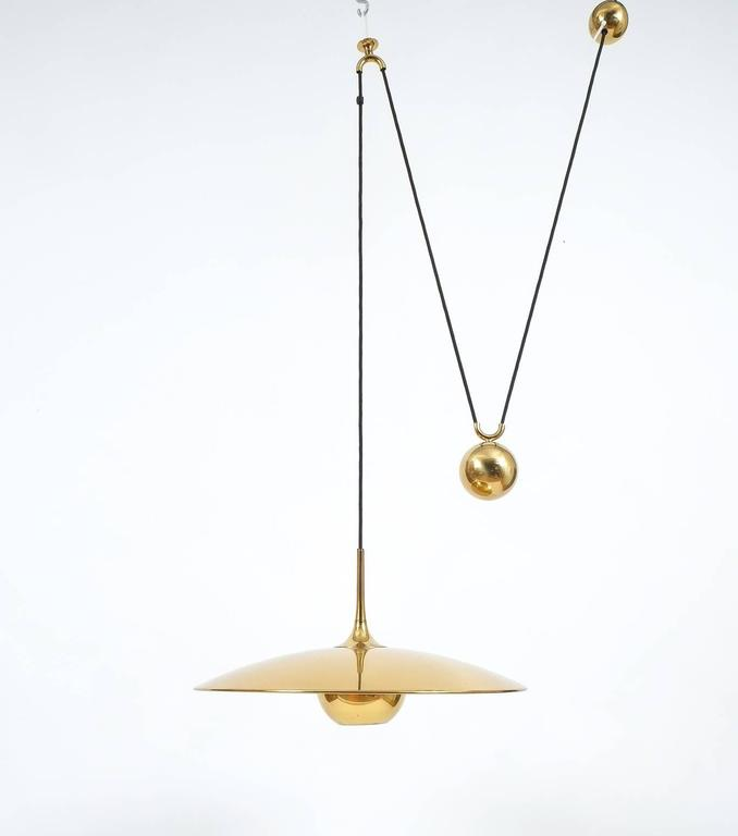 German Large Adjustable Polished Brass Counterweight Pendant by Florian Schulz