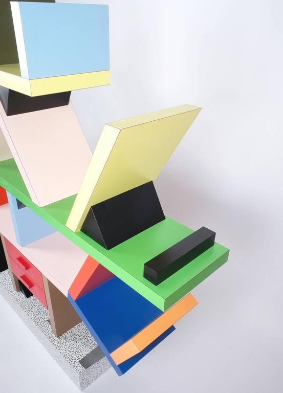 Colorful iconic 'Carlton' bookcase or room-divider designed by Ettore Sottsass for Memphis Milano in 1981. Heavy quality HPL (high pressure laminate) on wood construction in various colours. This piece derives from a production manufactured circa