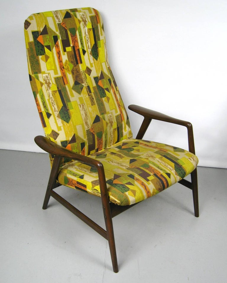 Reclining chair and ottoman by DUX. This may be the original fabric (which is fabulous but may need to be replaced) Wood is in great vintage condition with normal wear and slight imperfections. This is a must have for your Mid-Century Modern