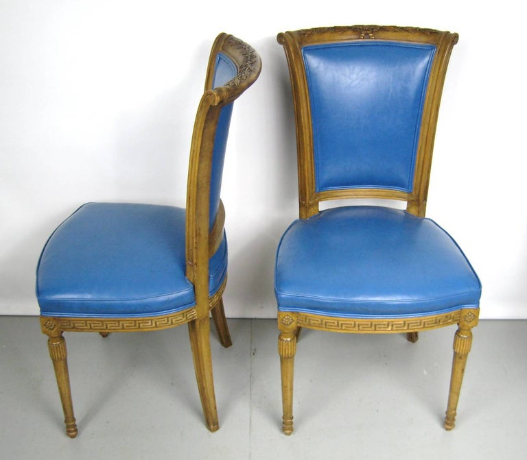 Two blue Italian Louis XVI neoclassical style chairs. The color on these is stunning. They measure 37 in H 23 in D 18.25 in wide, Seat height 18.5 in. We have a pair of captain chairs on our storefront that will go great with these. Please be sure