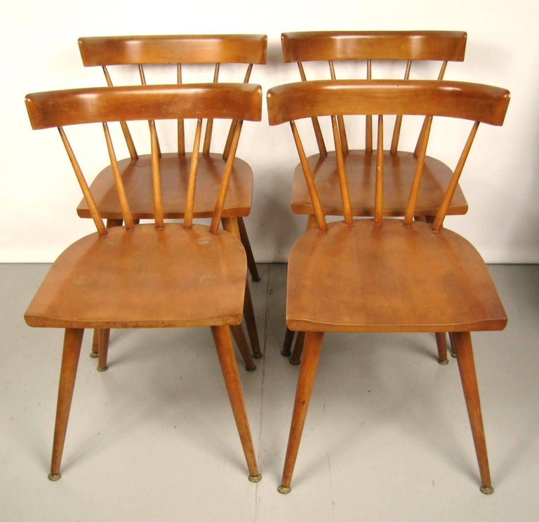 Maple Paul McCobb dining chairs set of four. Planner group. In wonderful vintage condition. Measuring: H 30 in W 17 in D 19 in Seat height: 17 in.