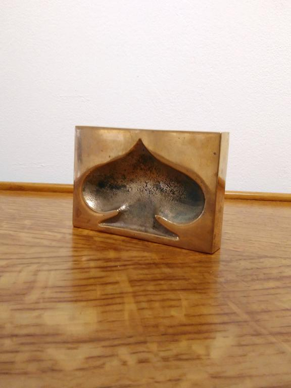 Patinated bronze paperweight.