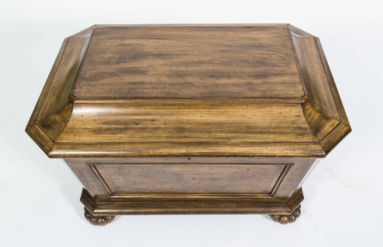 A Victorian sarcophagus shaped cellarette.  The Cooler is made of mahogany and the box features a rectangular top with beveled edges and four bun feet, with a lead lined and divided interior. Has multiple divisions in the interior.  The Cellerette