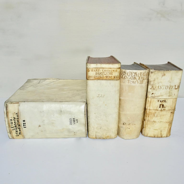 A collection of all vellum books from the 17th and 18th century in a set of four.