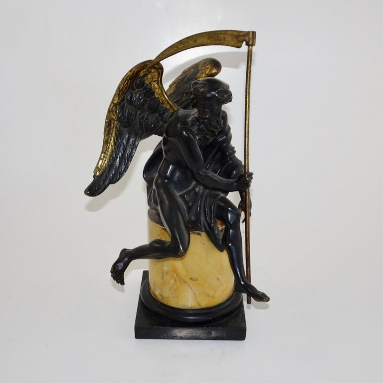 This statuette depicts the biblical angel from Revelations 14 in which the Bible says