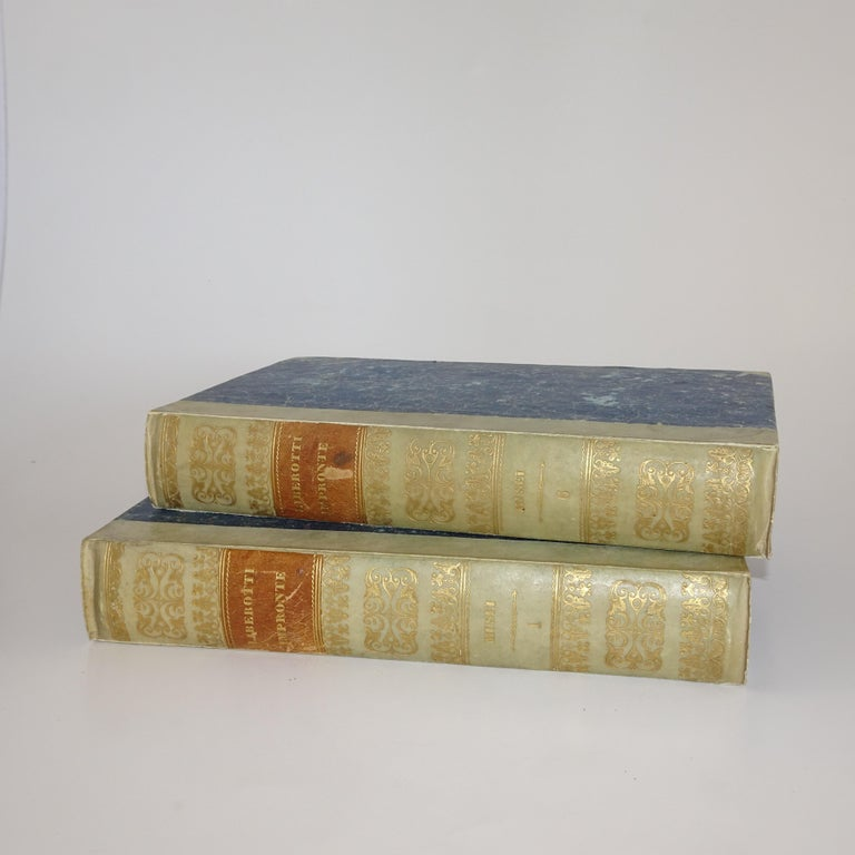 Original set of Grand Tour plaster intaglios. The set is in a double-sided box designed as a book with half marbled boards with gilt lettered vellum spine, speckled 'page edge'. Inside the front and back cover is a hand written key describing the
