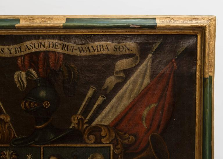19th century oil painting of coat of arms in a green and gilt custom frame.