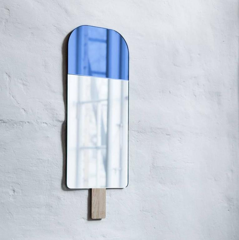 Ice cream mirror in Ocean Blue by Tor and Nicole Vitner Servé  Designed by Tor + Nicole Vitner Serve? Contemporary, Denmark, 2015 Ocean Blue and mirror glass, European oak Measures: H 22 in, W 8.5 in  Also available in Exotic Green, Hazel Brown,