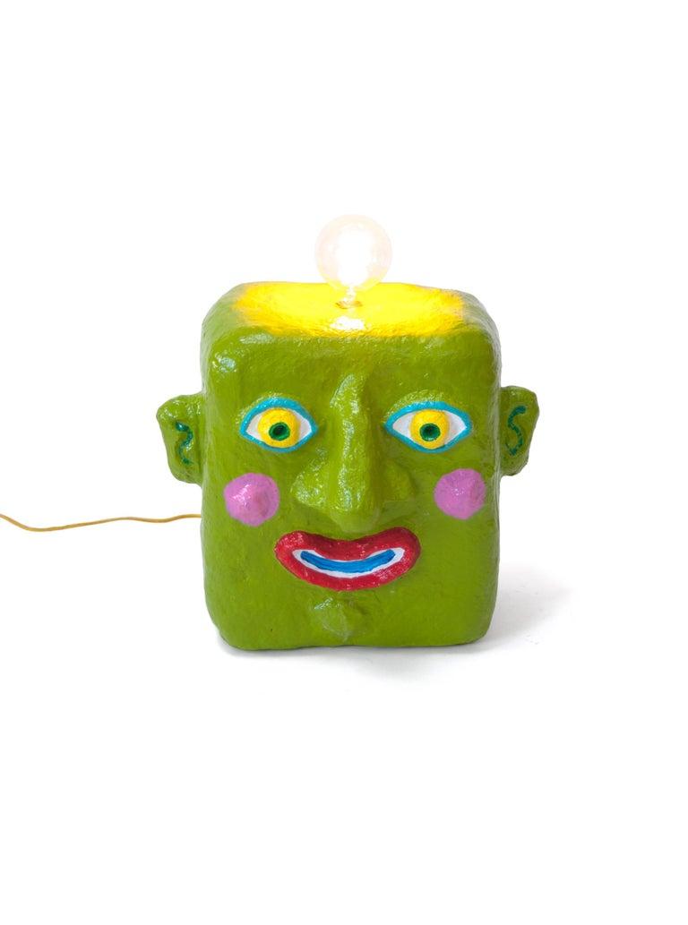 Green smile lamp by Brett Douglas Hunter, USA, 2018  Green smile lamp Brett Douglas Hunter, USA, 2018 Papercrete, Foam, Wire Measures: H 20 in, W 16 in, D 12 in.