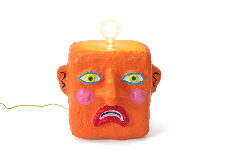 Orange Frown lamp by Brett Douglas Hunter, USA, 2018  Orange Frown lamp Brett Douglas Hunter, USA, 2018 Papercrete, foam, wire Measures: H 20 in, W 16 in, D 12 in.