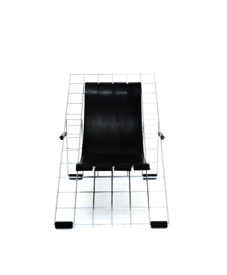Folding grid chair by Henner Kuckuck, USA, 1996, rubber and metal  Henner Kuckuck, USA, 1996 Rubber, metal Measures: H 21 in, W 20 in, D 31 in (seat H 8 in)  folds flat to 37 x 20 x 1 in.