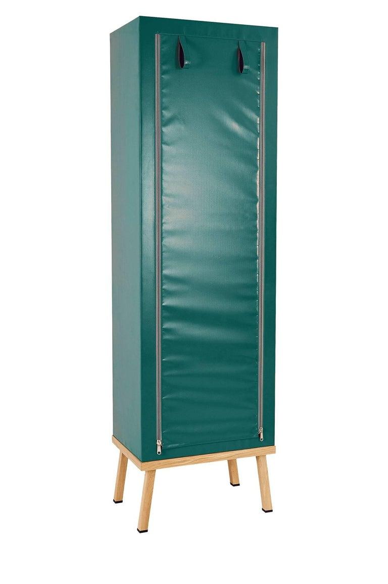 Visser and Meijwaard Truecolors cabinet in green PVC cloth with zipper opening  Designed by Visser en Meijwaard  Contemporary, Netherlands, 2015 PVC cloth, oakwood, rubber Measures: H 78.75 in, W 23.75 in, D 15.75 in   Lead time 8-10 weeks.