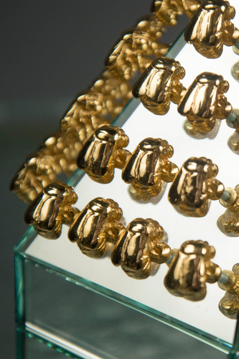 Hexagonal mirrored box, decorated with 60 gilded bronze bees, which are symmetrically aligned around the lid. The interior features glazed blonde wood.