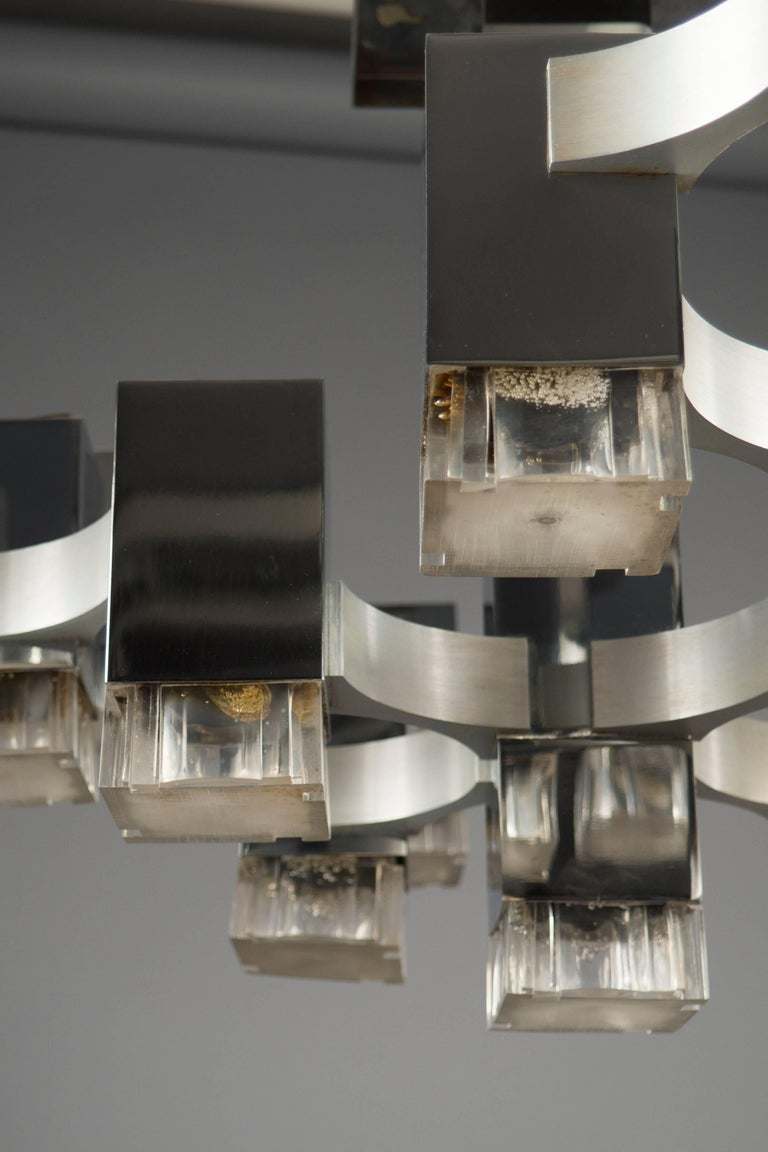 "Chrome-plated structure featuring 17 textured acrylic lights, from the ""cubic"" series. Some of the shades with slight heat marks."