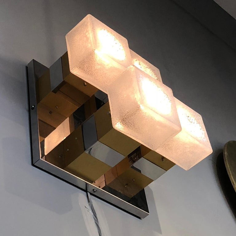 Nickel-plated and polished brass structure holding four square acid-etched glass shades.