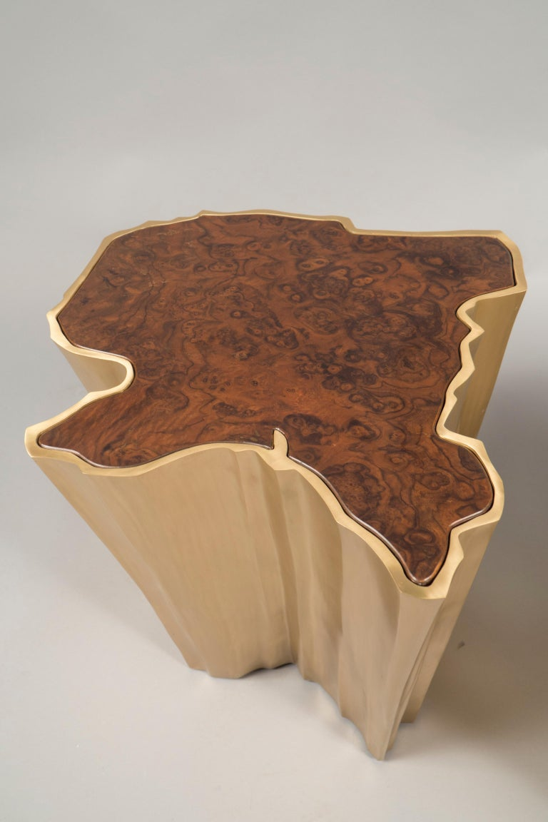 Patinated bronze bases in a rough tree trunk shape, the tops inserted with walnut root wood.