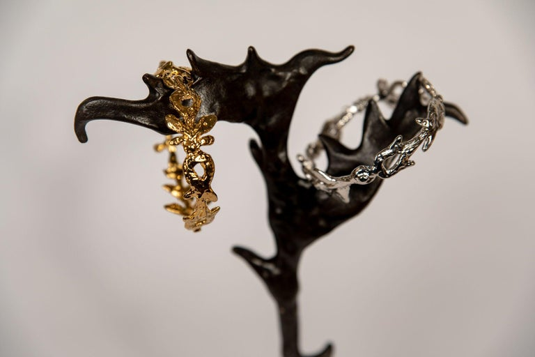 Bracelets are cast bronze in the lost wax technique and plated in silver or gold.