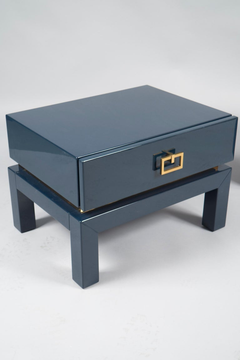 Pair of blue lacquered side tables with brass details throughout and one drawer. The lacquer has been refreshed through us.