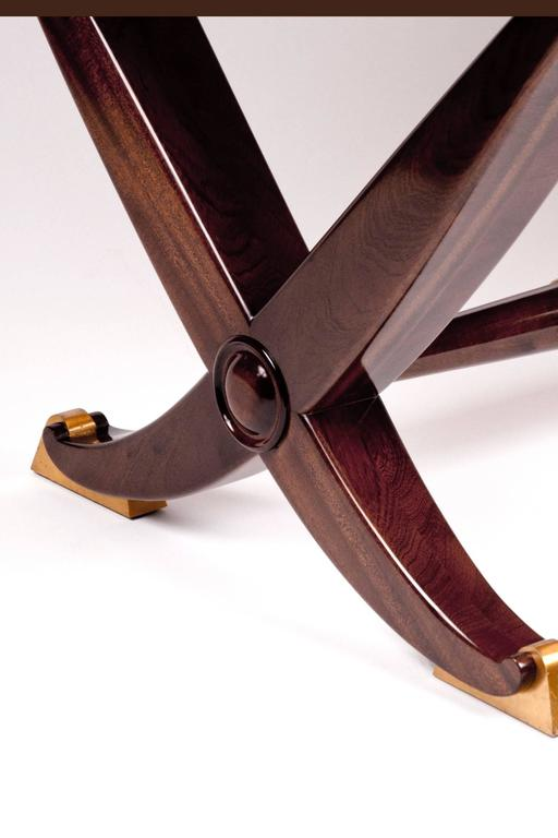 """Mahogany and wood table, neoclassical inspired style with X-form supports, a round stretcher and gilded bronze sabots. Rails underneath the top extend at both ends for possible extension leaves. Stamped """"2842"""" which is consistent with Arbus"""