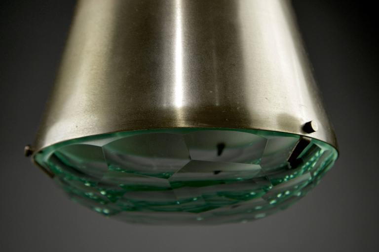 Conic lantern with a niello finish, mounted with faceted glass diffusers, suspended from a cord and canopy. Fontana Arte model 1995 (pictured in catalog) Literature: Franco Deboni's Fontana Arte three-light model illustrated in figure 321.    Body
