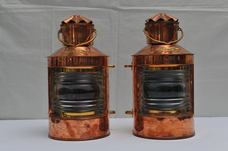 Pair of port and starboard navigational lights in a copper housing. Brass Heck nameplate on front, Fresnel lens which are indeed red and green with brass side mountings. Interior kerosene lights. Mid 1900s, fully restored.  Navigational and