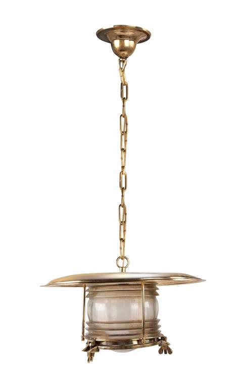 Large, midcentury ship post light in brass with Fresnel lens from a decommissioned Russian ship. Rewired and complete with brass chain and ceiling canopy. Diameter of just the glass or brass body is 9 inches.  Nautical antiques located on