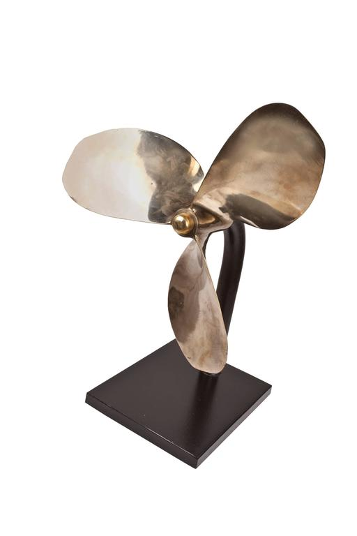 Large bronze propeller from a decommissioned lifeboat. Great scale and patina. Mounted on a custom made iron stand. Makes a wonderful sculptural piece with a history, 1970s. The base measures 12