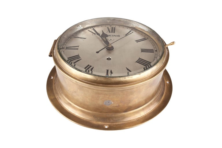 A handsome ship's clock in a brass casing with nickel face and roman numerals. Signed Viking. This is a spring mechanism clock which you wind every 8 days. In excellent working order. Easy to mount on the wall or place on a stand, circa 1960,