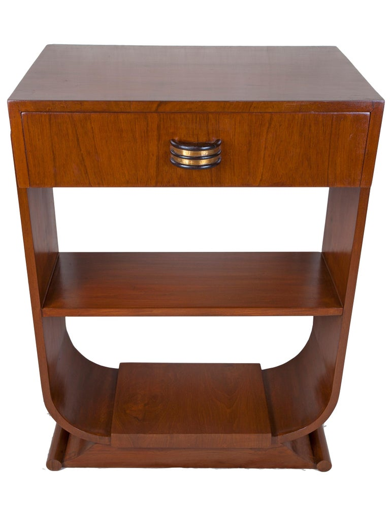 Pair of Mid-Century Modern teak side tables with rosewood and brass drawer pulls, u-shaped sides with middle shelf. Rolled end base. Perfect height for bedside or sofa tables. Refinished. Measures: Distance between shelves is 10