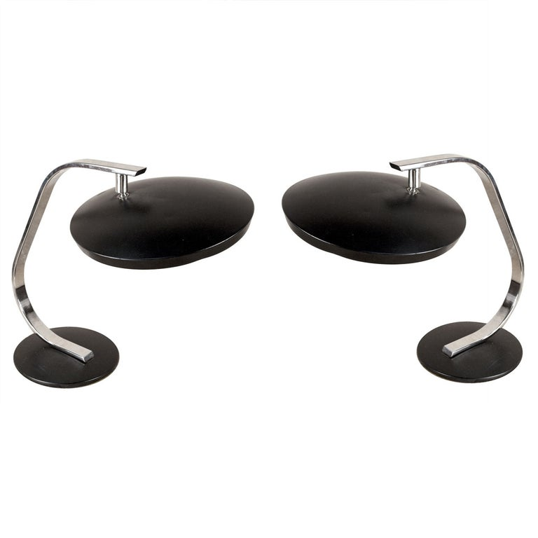 Pair of Fase (from Madrid), Mid-Century Modern chrome and enameled black metal desk lamps from a ship's stateroom. The shade is adjustable to tilt to any preferred angle. Just the shade has a 12 inch diameter and the base has an 8 inch diameter.