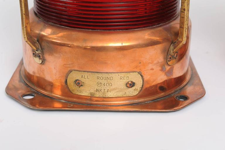 Pair of copper port and starboard all-around ship navigational lights. Midcentury from decommissioned ship and electrified for modern and American use. Glass Fresnel lenses.  Nautical antiques and artifacts