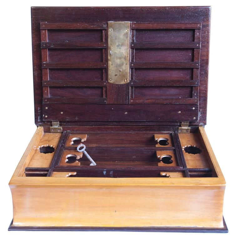 An early 1900s rosewood and satinwood book box with lock and key and intricate interior compartments. The interior tray lifts out for space underneath, documents and the like. Classy and discrete way to store and hide your valuables.