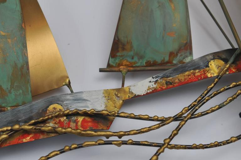 Signed and dated Curtis Jeré (Curtis Freiler and Jerry Fells) racing sailboats wall sculpture. Brass and copper with original patina, mounting brackets on reverse side. Brutalist period, 1969. These pieces are becoming highly collected as the