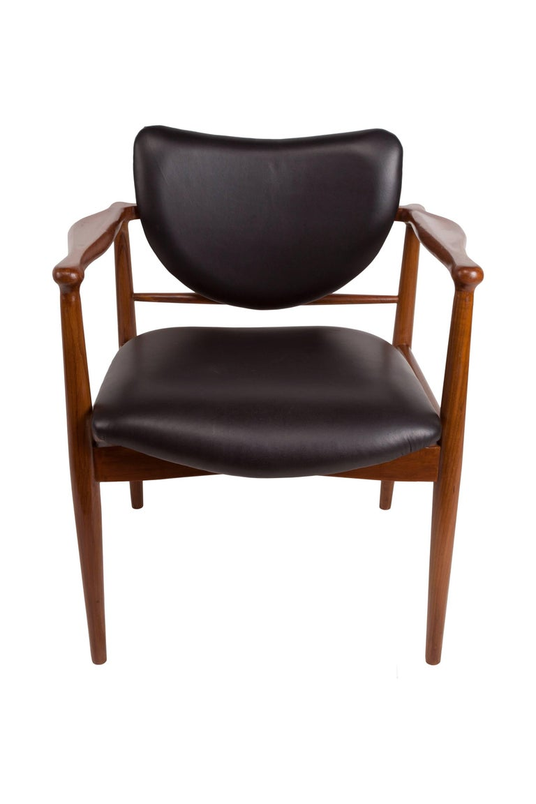 Fabulous Danish Mid-Century Modern teak and black leather chairs attributed to Finn Juhl for Baker. Great design and style, refinished and very comfortable. Leather upholstery redone. Great style, great lines.